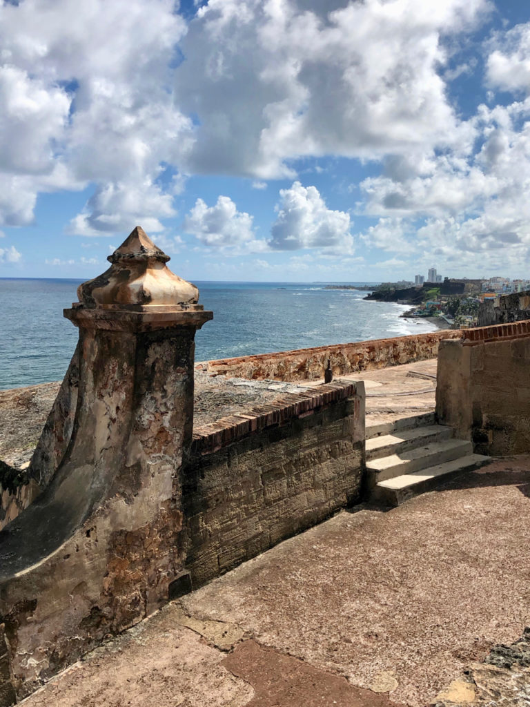 A picture of a wall in the fort at El Morro with the Atlantic Ocean in the background in Old San Juan, Puerto Rico