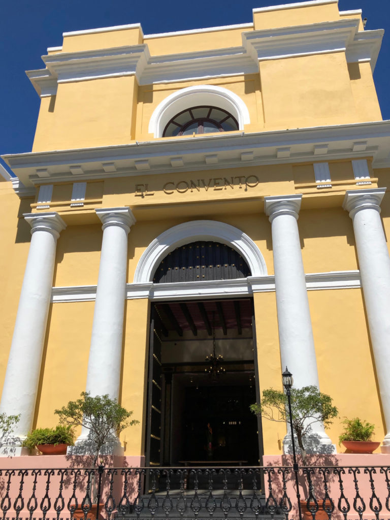 A Picture of the yellow facade of Hotel El Convento in Old San Juan