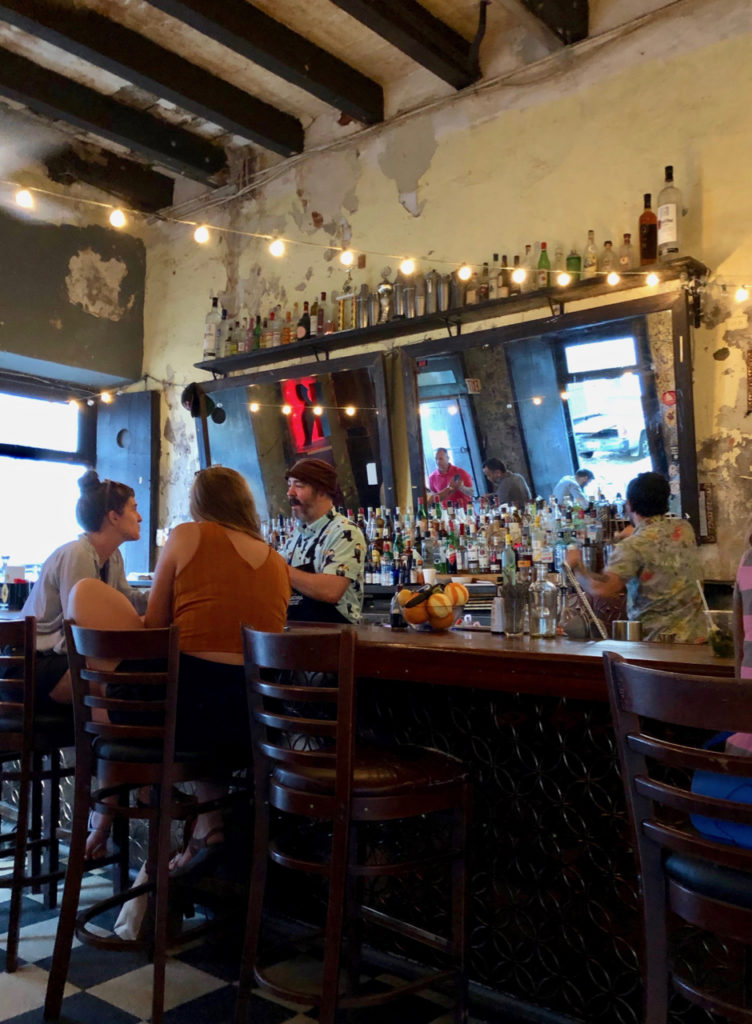 A picture of a bar with customers and bartenders in Old San Juan