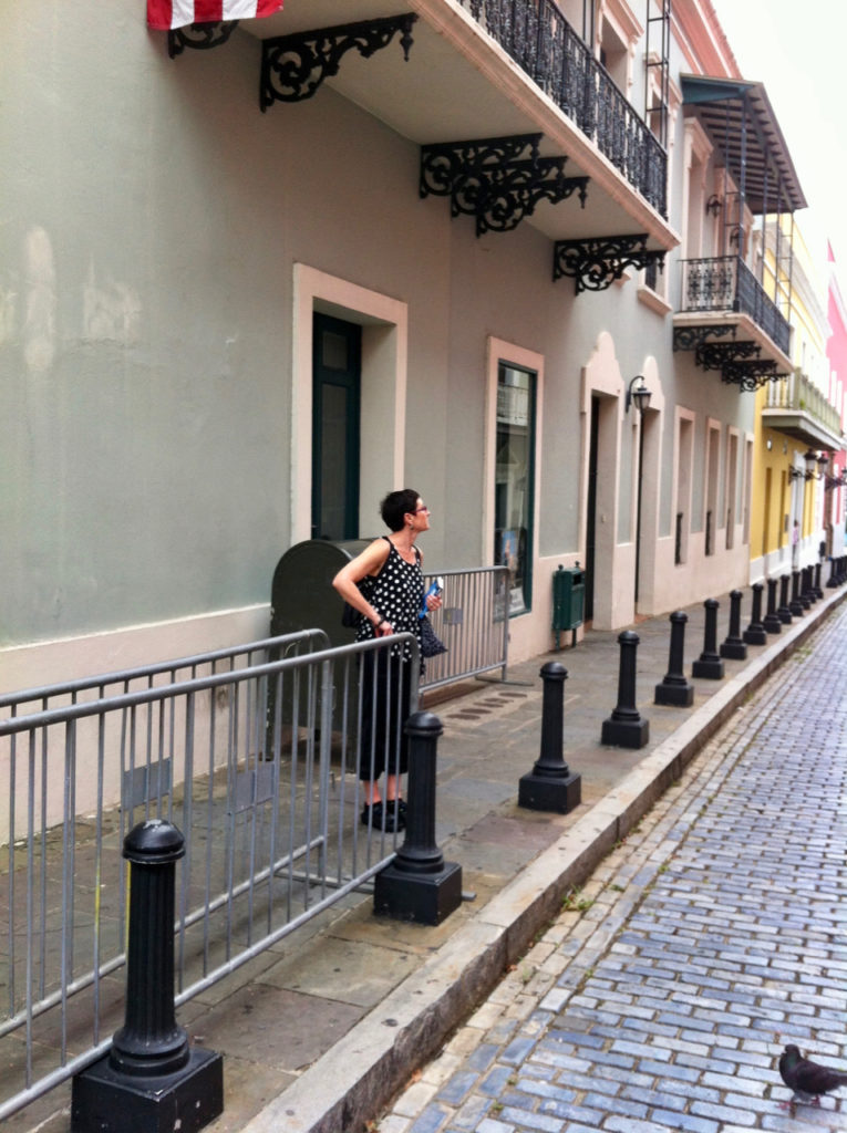 A picture of One Day Woman on a sidewalk in Old San Juan, Puerto Rico