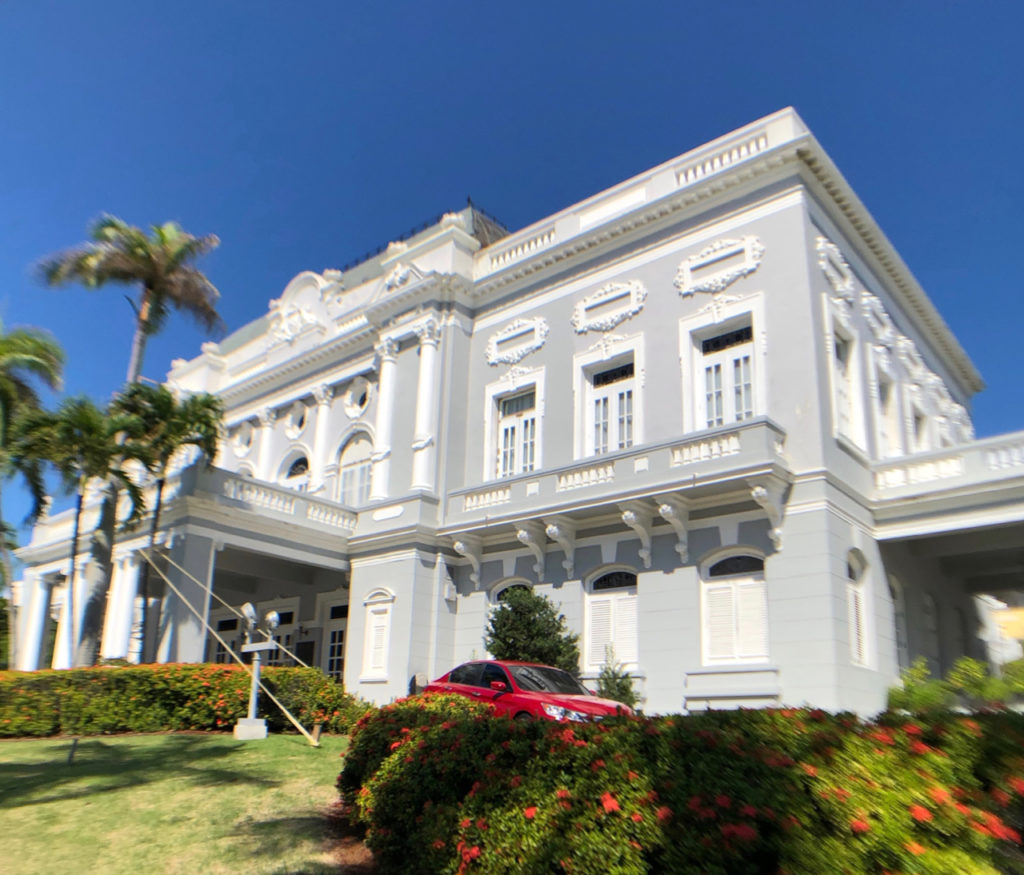 A picture of a beautiful grey and white building that is the Old Casino of Puerto Rico in Old San Juan, Puerto Rico