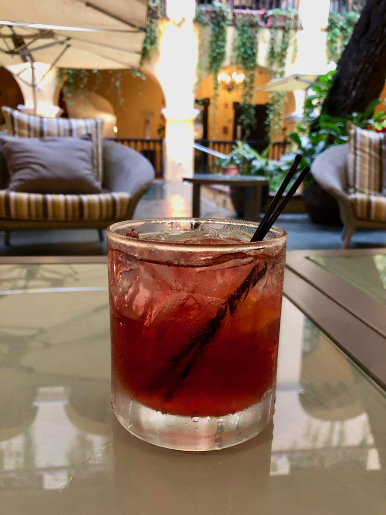A picture of A Puerto Rican Rum Cocktail sitting on a table at Patio del Nispero Restaurant