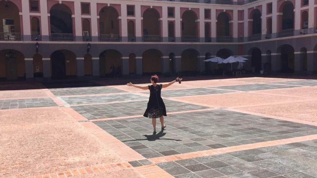 A picture of the interior the Cuartel De Ballaja in Old San Juan, Puerto Rico with One Day Woman in the middle