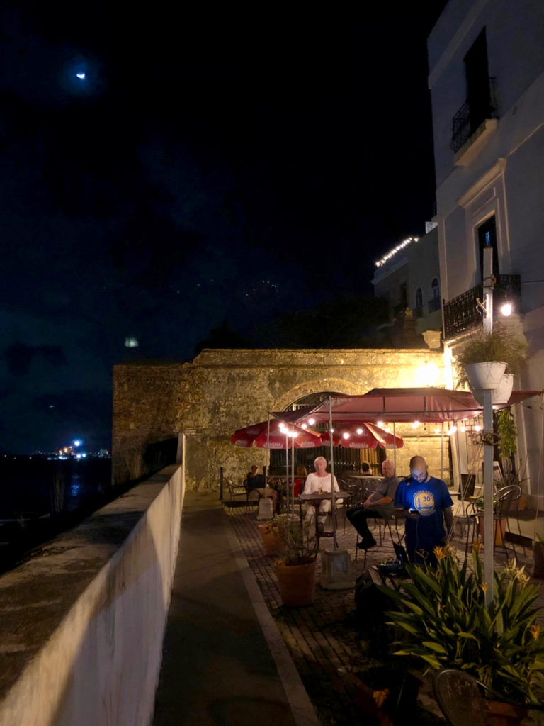 A picture of outdoor seating at the restaurant T.tuan Old San Juan at Night